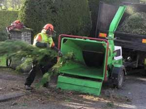 man using a chipper